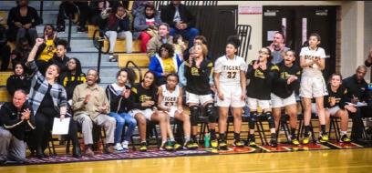 Girls varsity basketball team cheering after scoring. Photo courtesy of @JWGirlsBball Twitter