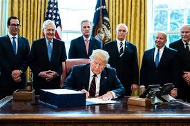 President Donald Trump signed the CARES Act into law on March 27. This Act includes $2 trillion to be distributed among families and businesses, making it the largest stimulus plan in US history. Photo courtesy of CNBC.